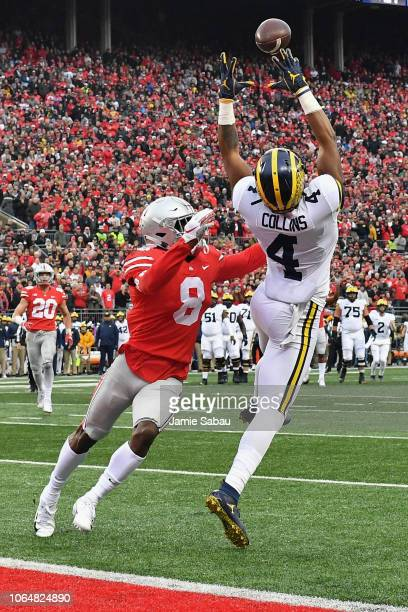 Nico Collins of the Michigan Wolverines catches a 23-yard touchdown pass in as Kendall Sheffield of the Ohio State Buckeyes defends in the second...