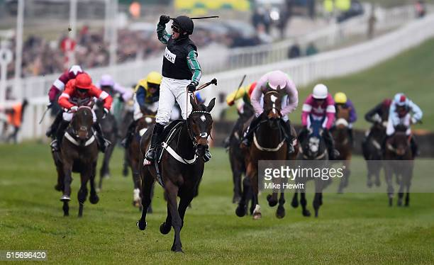 Nico de Boinville and Altior win the Sky Bet Supreme Novices' Hurdle at Cheltenham Racecourse on March 15 2016 in Cheltenham England