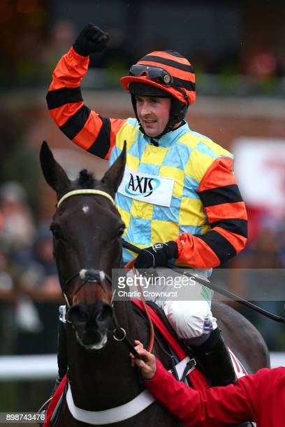 Nico de Boinville celebrates after he ride Might Bite to win The 32Red King George VI Steeple Chase at Kempton Park racecourse on December 26 2017 in...