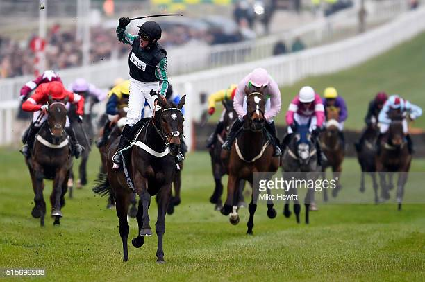 Nico de Boinville celebrates after riding Altior to victory in the Sky Bet Supreme Novices' Hurdle Race on day one Champion Day of the Cheltenham...