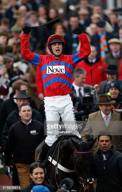 Nico de Boinville celebrates after riding Sprinter Sacre to win The Betway Queen Mother Champion Steeple Chase at Cheltenham racecourse on March 16,...
