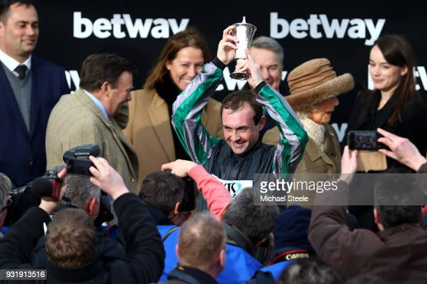 Nico de Boinville celebrates after winning the Betway Queen Mother Champion Chase with Altior during Cheltenham Festival Ladies Day at Cheltenham...