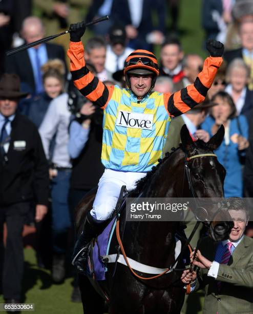 Nico De Boinville celebrates on board Might Bite after vidtory in the RSA Novices Steeple Chase during Ladies Day of the Cheltenham Festival at...