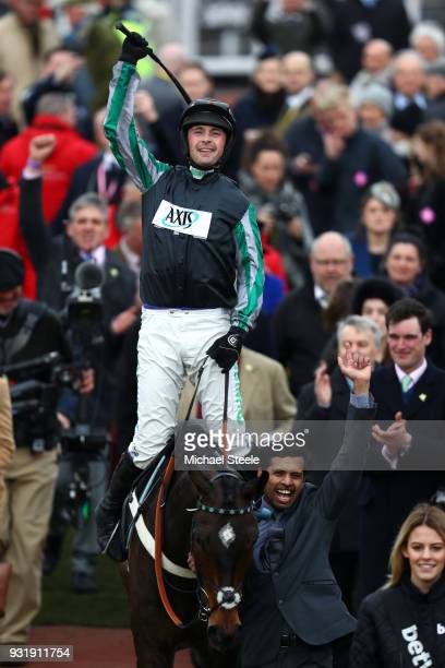 Nico de Boinville on Altiorcelebrates winning the Betway Queen Mother Champion Chase during Cheltenham Festival Ladies Day at Cheltenham Racecourse...