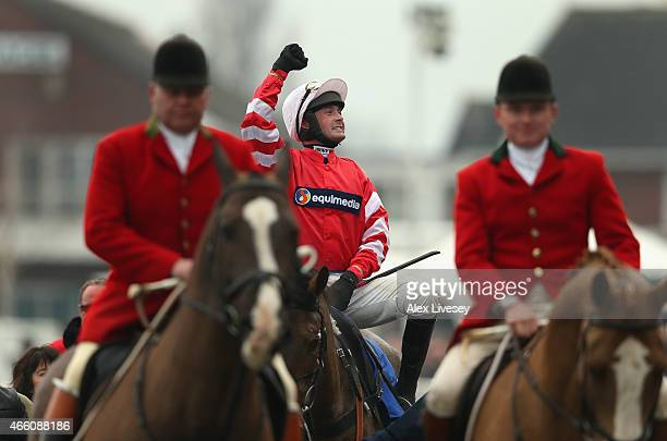 Nico de Boinville on Coneygree celebrates ad they are led in past the grandstand after winning the Betfred Cheltenham Gold Cup Chase during the...