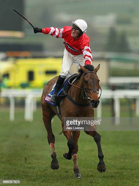 Nico de Boinville on Coneygree celebrates after winning the Betfred Cheltenham Gold Cup Chase during the Cheltenham Gold Cup day at the Cheltenham...