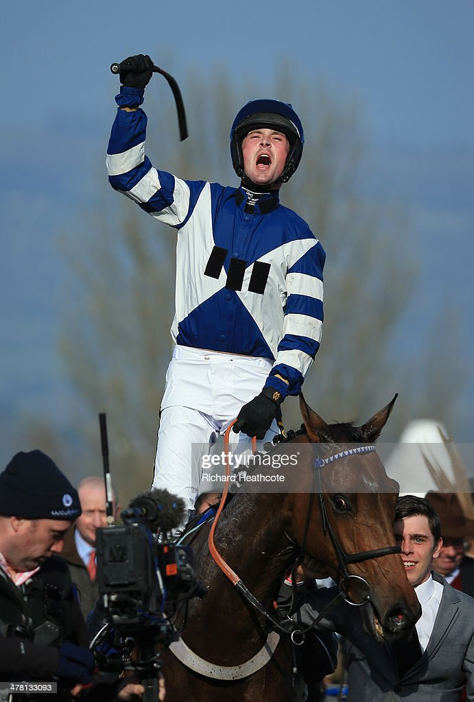 Nico de Boinville on Whisper celebrates victory in The Coral Cup during Ladies Day at the Cheltenham Festival at Cheltenham Racecourse on March 12, 2014 in Cheltenham, England.