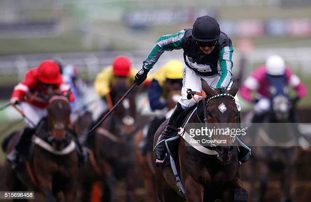 Nico de Boinville riding Altior clear the last to win The Sky Bet Supreme Novices' Hurdle Race at Cheltenham racecourse on March 15 2016 in...