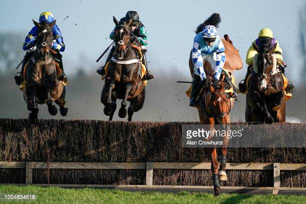 Nico de Boinville riding Altior clear the water jump before going on to win The Win Bigger On The Betfair Exchange Chase as Jonathan Burke riding Bun...