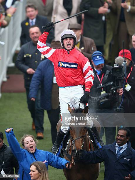 Nico de Boinville riding Coneygree celebrates as he enters the winners enclosure after victory in the Betfred Cheltenham Gold Cup during day four of...