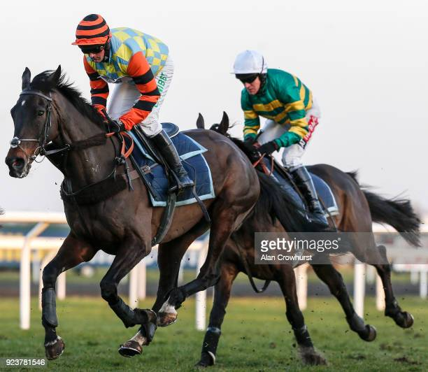 Nico de Boinville riding Might Bite and Buveur D'Air ridden by Barry Geraghty gallop after racing at Kempton Park racecourse on February 24 2018 in...