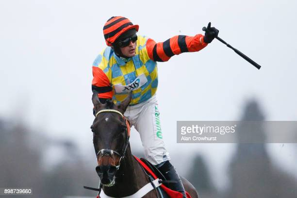 Nico de Boinville riding Might Bite celebrates winning The 32Red King George VI Steeple Chase at Kempton Pak racecourse on December 26 2017 in...