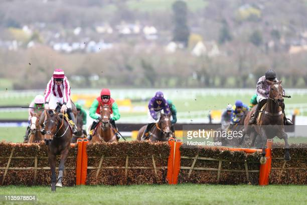 Nico de Boinville riding Pentland Hills jumps over the last hurdle to win the Triumph Hurdle race ahead of Davy Russell riding Coeur Sublime during...
