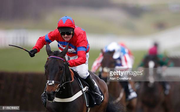 Nico de Boinville riding Sprinter Sacre clear the last to win The Betway Queen Mother Champion Steeple Chase at Cheltenham racecourse on March 16...