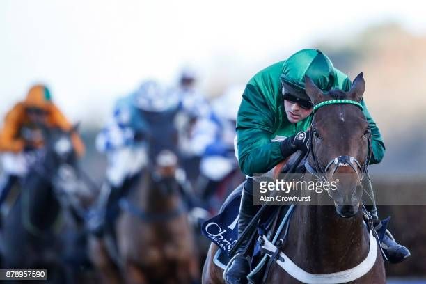Nico de Boinville riding Top Notch clear the last to win The Christy 1965 Steeple Chase at Ascot racecourse on November 25 2017 in Ascot United...