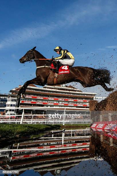 Nico de Boinville riding Willoughby Court clear the water jump on their way to winning The Ladbrokes Novices' Steeple Chase at Newbury racecourse on...