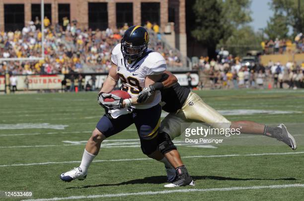 Nico Dumont of the California Golden Bears makes a two yard reception for a touchdown as Anthony Perkins of the Colorado Buffaloes defends in the...