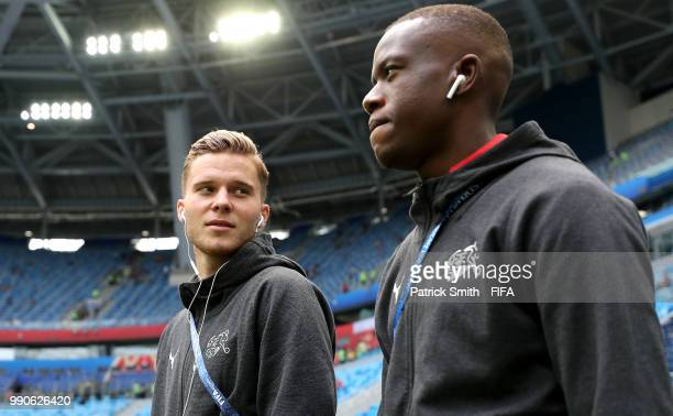 Nico Elvedi and Denis Zakaria of Switzerland look on during pitch inspection prior to the 2018 FIFA World Cup Russia Round of 16 match between Sweden...