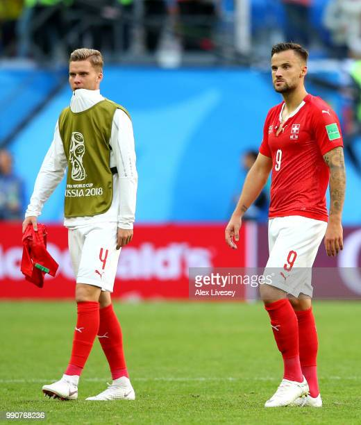 Nico Elvedi and Haris Seferovic of Switzerland shows his dejection following the 2018 FIFA World Cup Russia Round of 16 match between Sweden and...