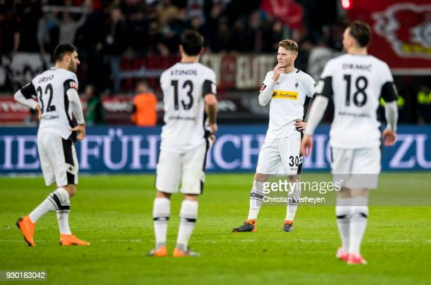 Nico Elvedi and how team mates of Borussia Moenchengladbach react after Leverkusens second goal during the Bundesliga match between Bayer 04...