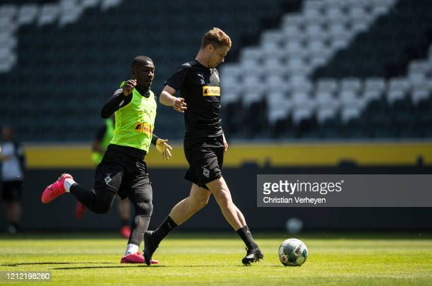 Nico Elvedi and Marcus Thuram in action during a training session of Borussia Moenchengladbach at BorussiaPark on May 08 2020 in Moenchengladbach...
