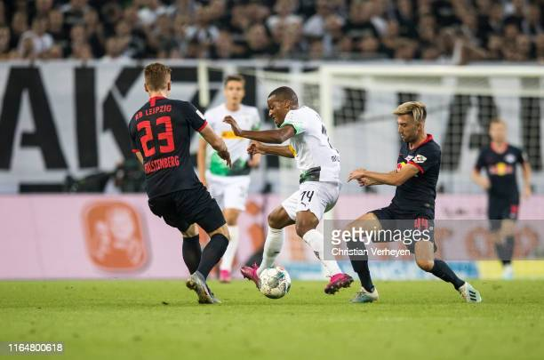 Nico Elvedi and Oscar Wendt Alassane Plea of Borussia Moenchengladbach and Marcel Halstenberg and Kevin Kampl of RB Leipzig battle for the ball...