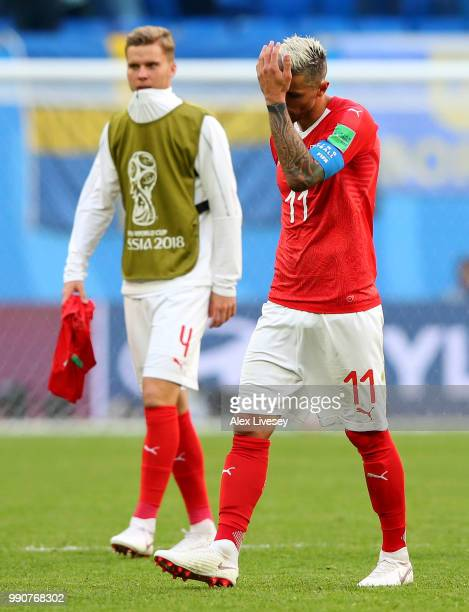 Nico Elvedi and Valon Behrami of Switzerland shows his dejection following the 2018 FIFA World Cup Russia Round of 16 match between Sweden and...