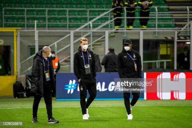 Nico Elvedi, Breel Embolo and Assistant Coach Oliver Neuville of Borussia Moenchengladbach are seen before the Group B - UEFA Champions League match...