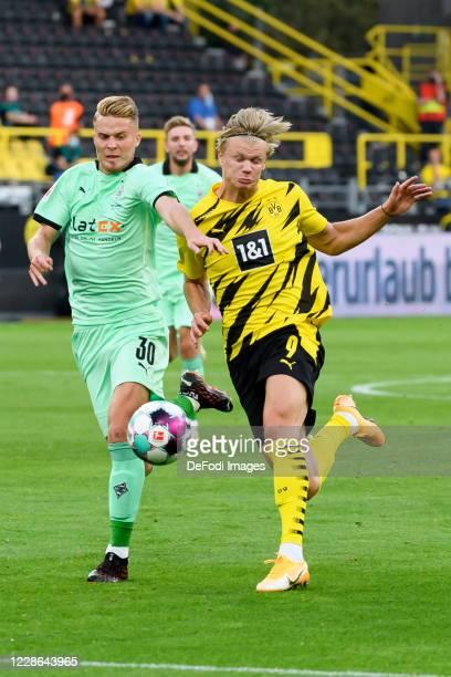 Nico Elvedi of Borussia Moenchengladbach and Erling Haaland of Borussia Dortmund battle for the ball during the Bundesliga match between Borussia...