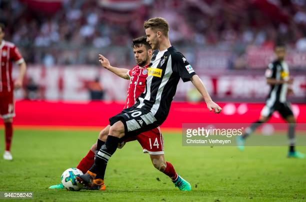 Nico Elvedi of Borussia Moenchengladbach and Juan Bernat of FC Bayern Muenchen battle for the ball during the Bundesliga match between FC Bayern...