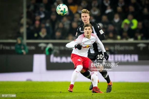 Nico Elvedi of Borussia Moenchengladbach and Marcel Sabitzer of RB Leipzig battle for the ball during the Bundesliga match between Borussia...