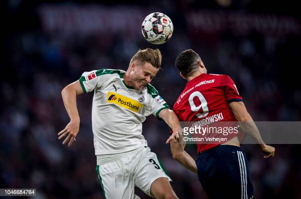 Nico Elvedi of Borussia Moenchengladbach and Robert Lewandowski of FC Bayern Muenchen battle for the ball during the Bundesliga match between FC...