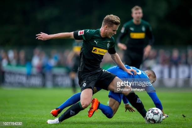 Nico Elvedi of Borussia Moenchengladbach and Sidney Sam of VfL Bochum battle for the ball during the friendly match between Borussia Moenchengladbach...