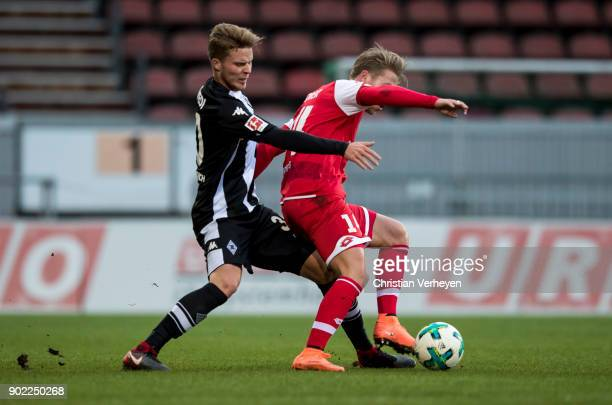 Nico Elvedi of Borussia Moenchengladbach and Viktor Fischer of FSV Mainz 05 battle for the ball during the preseason friendly match between 1 FSV...