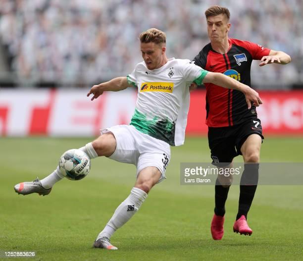 Nico Elvedi of Borussia Moenchengladbach battles for possession with Krzysztof Piatek of Hertha BSC during the Bundesliga match between Borussia...