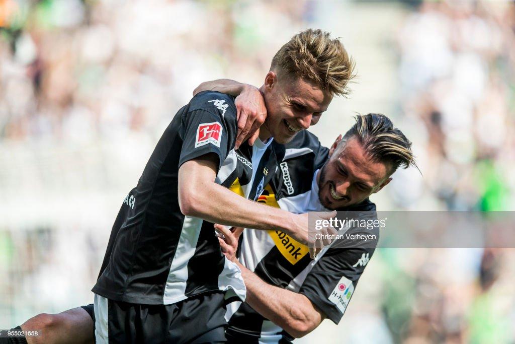 Nico Elvedi of Borussia Moenchengladbach celebrate his second goal with team mate Josip Drmic during the Bundesliga match between Borussia Moenchengladbach and SC Freiburg at Borussia-Park on May 05, 2018 in Moenchengladbach, Germany.