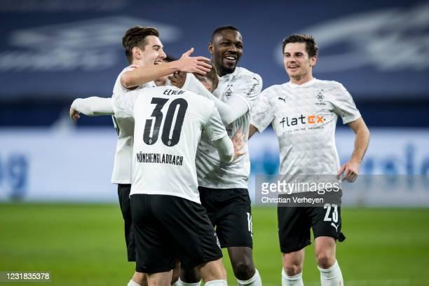 Nico Elvedi of Borussia Moenchengladbach celebrate with team mate Marcus Thuram after he score his teams third goal during the Bundesliga match...