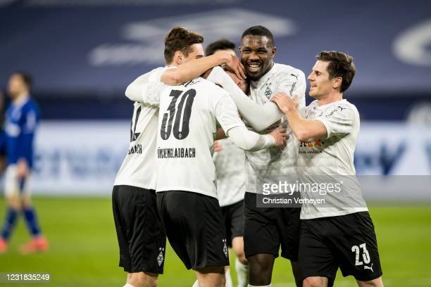 Nico Elvedi of Borussia Moenchengladbach celebrate with team mates after he score his teams third goal during the Bundesliga match between FC Schalke...