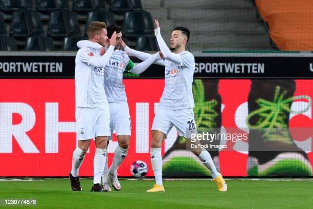 Nico Elvedi of Borussia Moenchengladbach celebrates after scoring his team's first goal during the Bundesliga match between Borussia Moenchengladbach...