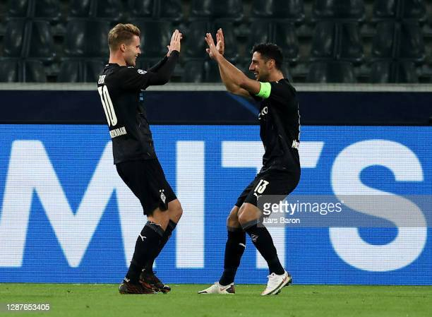 Nico Elvedi of Borussia Moenchengladbach celebrates with Lars Stindl after scoring their team's second goal during the UEFA Champions League Group B...