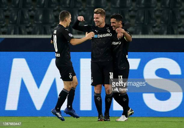 Nico Elvedi of Borussia Moenchengladbach celebrates with Lars Stindl and Stefan Lainer after scoring their team's second goal during the UEFA...