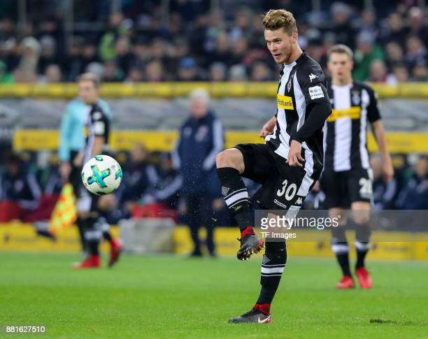 Nico Elvedi of Borussia Moenchengladbach controls the ball during the Bundesliga match between Borussia Moenchengladbach and FC Bayern Muenchen at...