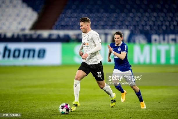 Nico Elvedi of Borussia Moenchengladbach in action during the Bundesliga match between FC Schalke 04 and Borussia Moenchengladbach at Veltins-Arena...
