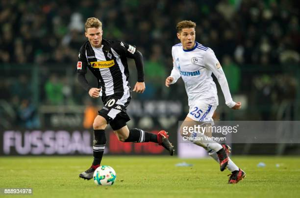 Nico Elvedi of Borussia Moenchengladbach is chased by Amine Harit of FC Schalke 04 during the Bundesliga match between Borussia Moenchengladbach and...