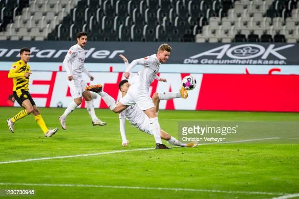 Nico Elvedi of Borussia Moenchengladbach scores his teams first goal during the Bundesliga match between Borussia Moenchengladbach and Borussia...