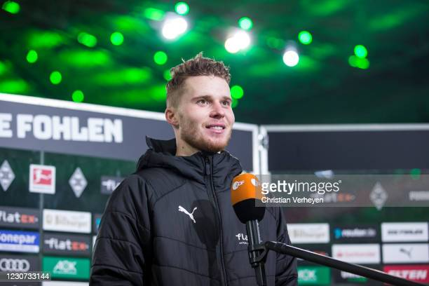Nico Elvedi of Borussia Moenchengladbach talks to the media after the Bundesliga match between Borussia Moenchengladbach and Borussia Dortmund at...