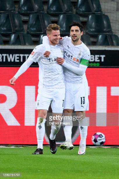 Nico Elvedi of Borussia Moenchengladbach with Lars Stindl of Borussia Moenchengladbach celebrates after scoring his team's second goal during the...