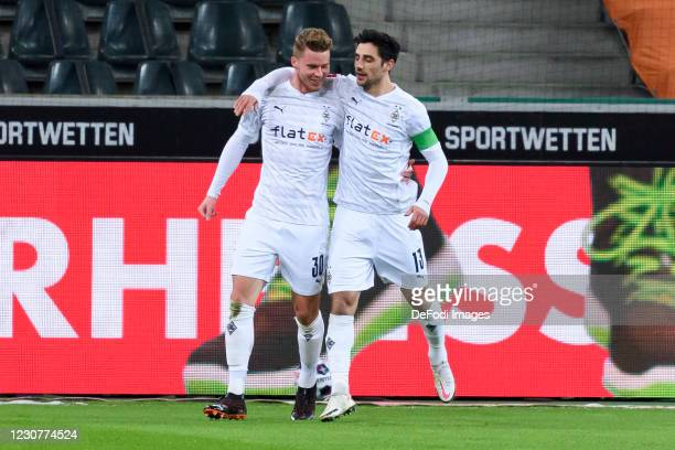 Nico Elvedi of Borussia Moenchengladbach with Lars Stindl of Borussia Moenchengladbach celebrates after scoring his team's first goal during the...