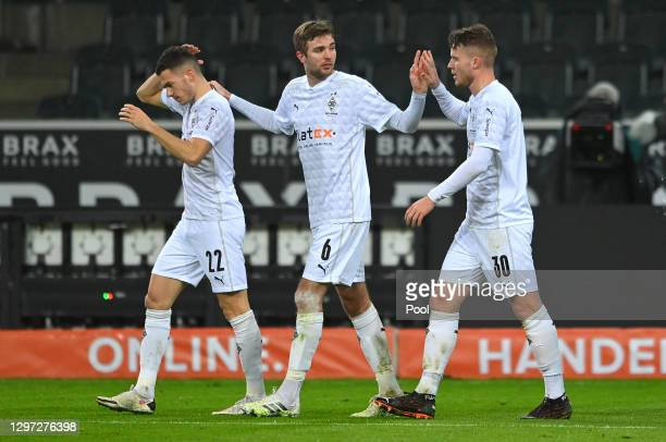 Nico Elvedi of Borussia Monchengladbach celebrates after scoring their sides first goal with team mates Laszlo Benes and Christoph Kramer during the...
