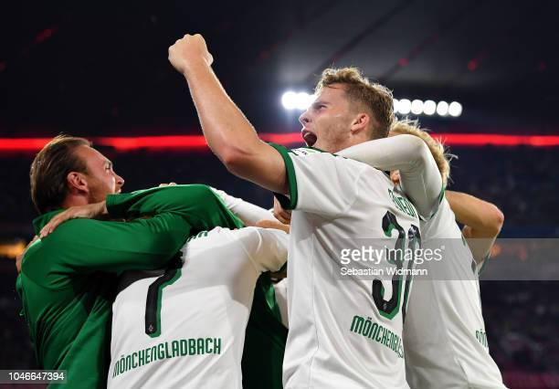 Nico Elvedi of Borussia Monchengladbach celebrates his team's third goal during the Bundesliga match between FC Bayern Muenchen and Borussia...